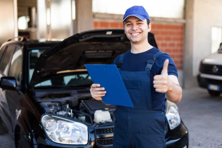 Man giving thumbs up after checking car parts
