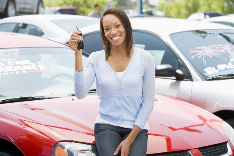 Woman picking up new car from lot