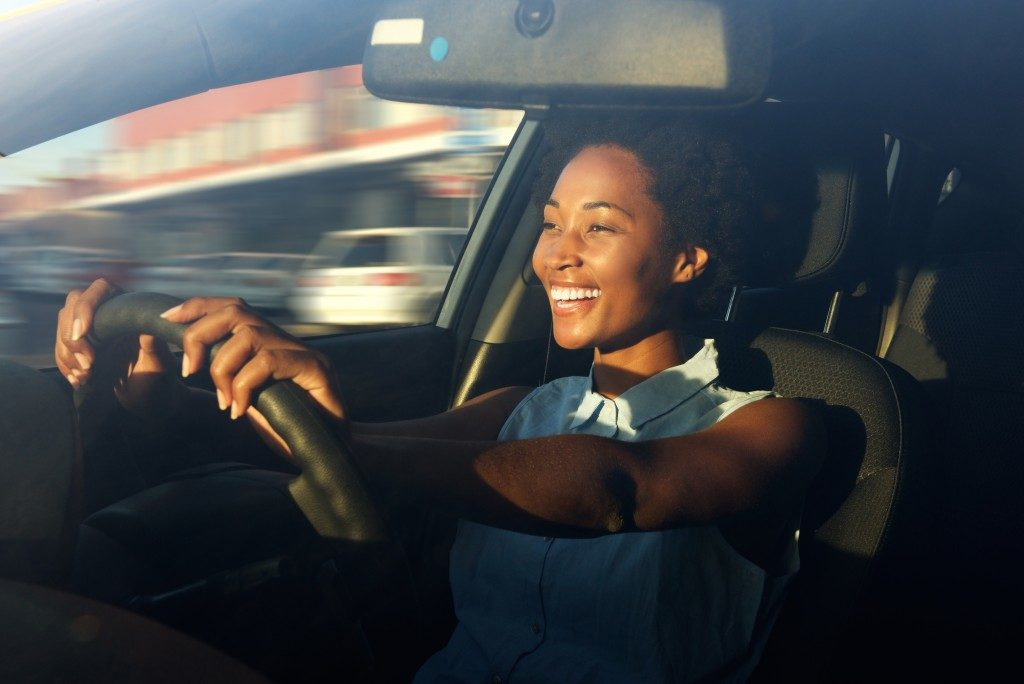 Woman driving the car happily