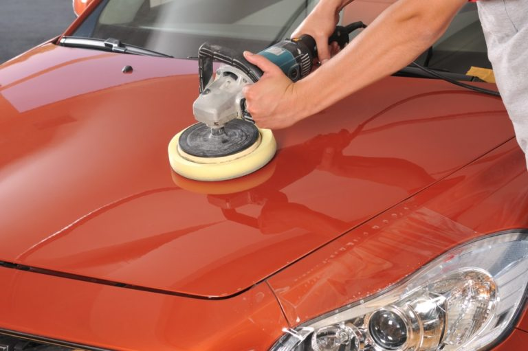 person cleaning a car