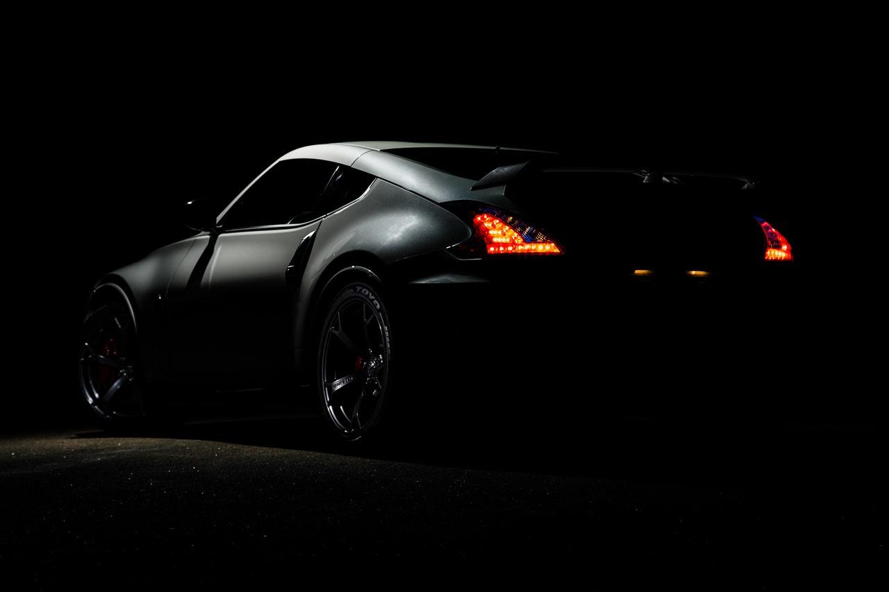 a black car on a dark street