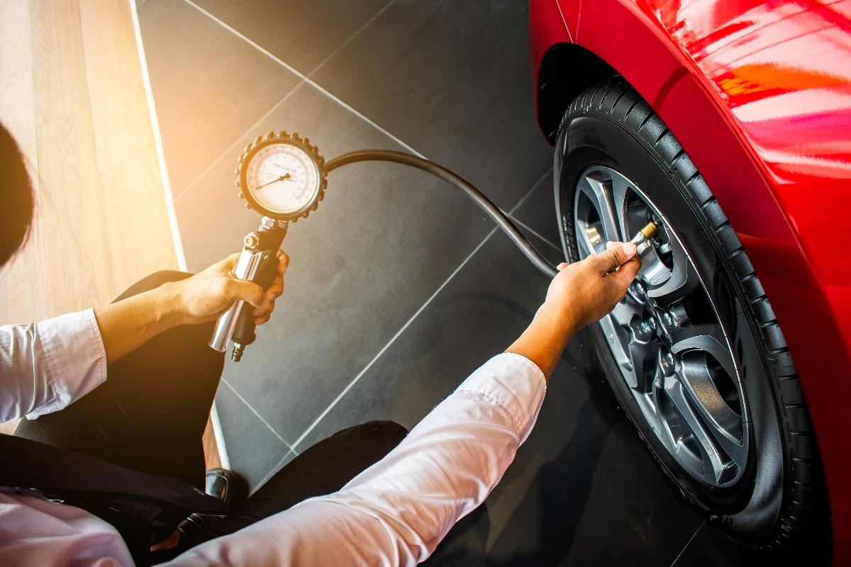 man fixing a flat tire